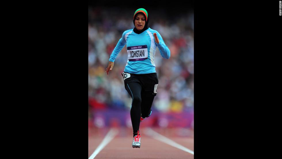 Tahmina Kohistani of Afghanistan competes in the women's 100-meter heat.
