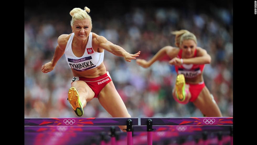 Poland's Karolina Tyminska, left, competes in the women's heptathlon 100-meter hurdles heat.