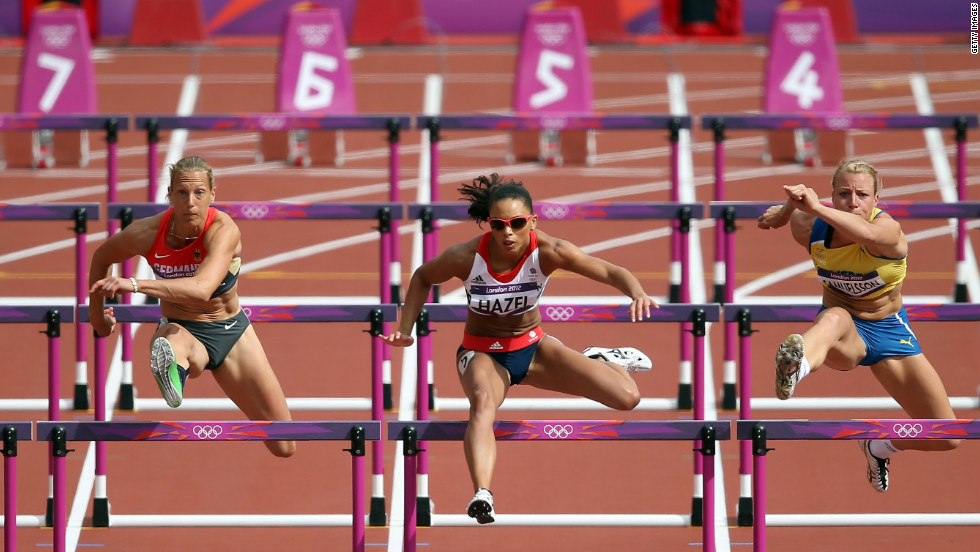 From left, Jennifer Oeser of Germany, Louise Hazel of Great Britain and Jessica Samuelsson of Sweden compete in the women's heptathlon 100-meter hurdles heat.