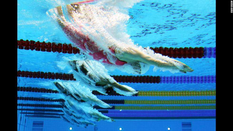 Jolien Sysmans of Belgium dives into the water at the start of the women's 50-meter freestyle heat.