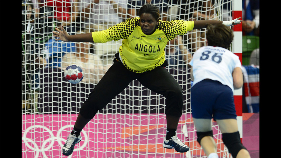 Angolan goalkeeper Cristina Direito tries to make a save during a women's preliminary handball match against Great Britain.