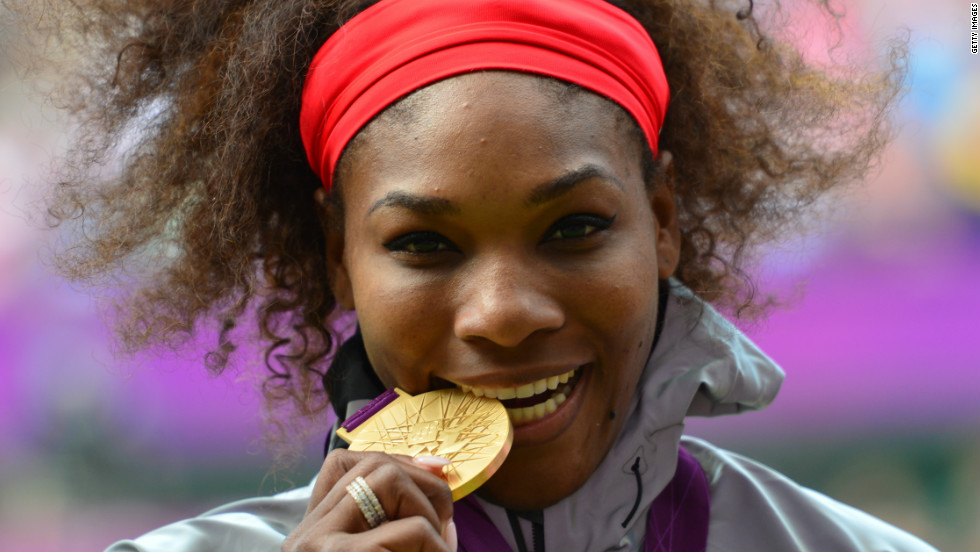 Serena Williams takes the customary bite out of her Olympic gold medal for women's tennis singles. Williams won two gold medals during the London 2012 games, the second with her sister in the doubles final at Wimbledon.