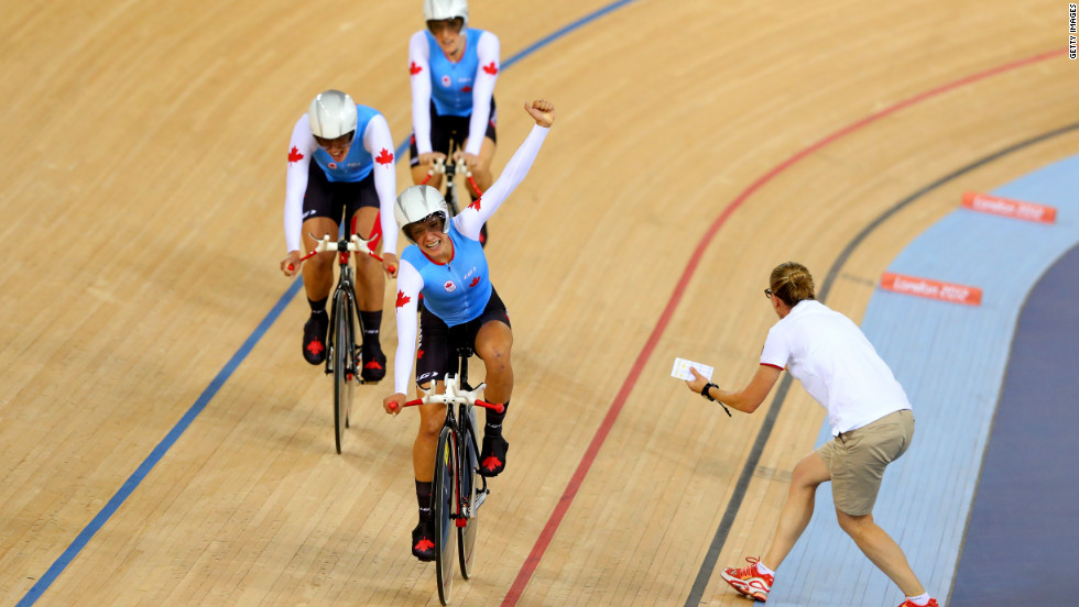 Tara Whitten, Gillian Carleton and Jasmin Glaesser of Canada celebrate as they win the bronze medal in women's team pursuit track cycling.