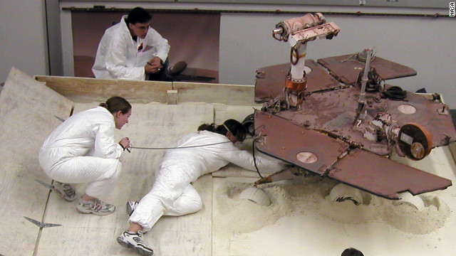 "Scott Maxwell, top, Kim Lichtenberg, left, and Pauline Hwang test how to get Spirit out of a Martian ""sand trap."""