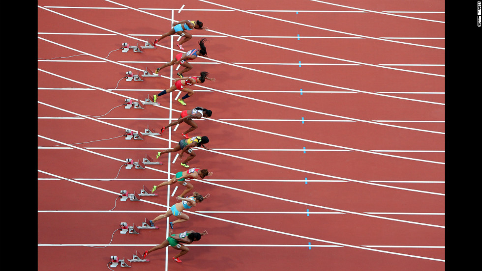 Athletes start in the women's 100-meter semifinal at Olympic Stadium.