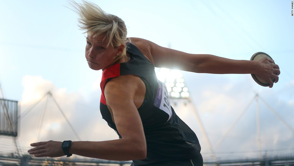 Nadine Muller of Germany competes in the final of the women's discus throw.