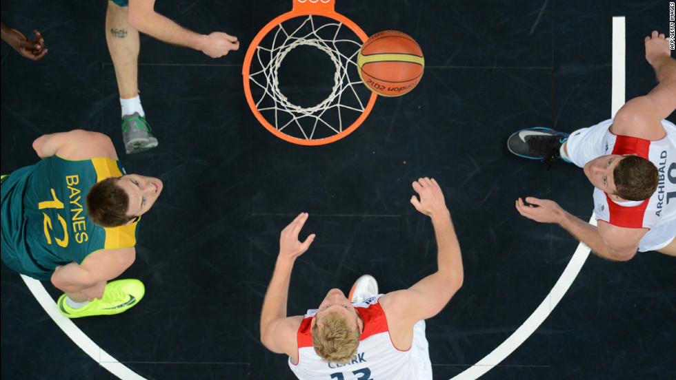 Left to right: Australian center Aron Baynes, British forward Dan Clark and British forward Robert Archibald eye the ball during a men's preliminary round group B basketball match.