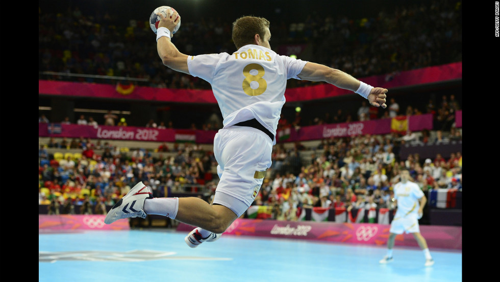 Spain's rightwing Victor Tomas Gonzalez jumps to shoot during the men's preliminary  handball match against Hungary.