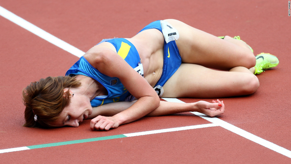 Valentyna Horpynych Zhudina of Ukraine lies on the track after competing in the women's 3000-meter steeplechase.