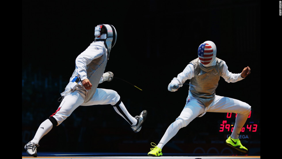 Erwan Le Pechoux of France faces off against Alexander Massialas of the United States during the men's foil team fencing quarterfinal.