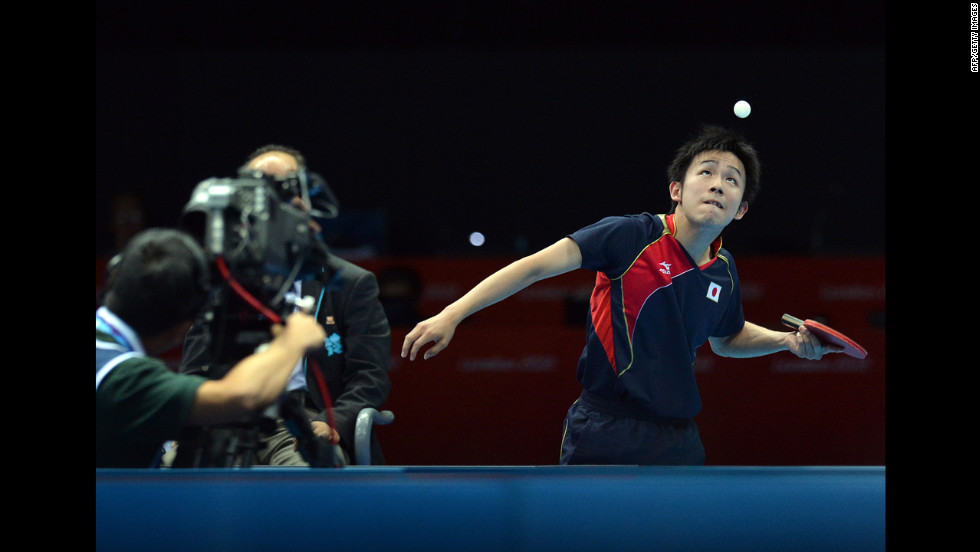 Japan's Koki Niwa serves to Hong Kong's Tang Peng during a men's team table tennis quarterfinal match.