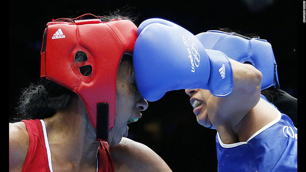Erika Matos, left, of Brazil takes a punch from Karlha Magliocco of Venezuela in a women's flyweight boxing round of 16 match.