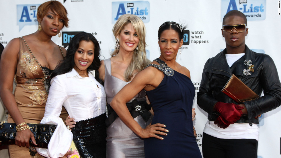 """Lawrence Washington, right, is a hairstylist, singer and friend of """"The Real Housewives of Atlanta."""""""