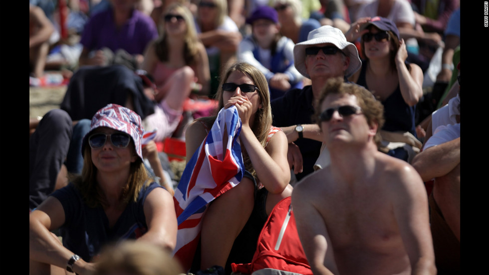 Crowds watch sailing on large screens erected on the beach in Weymouth, England. Ben Ainslie of Great Britain became the most-decorated Olympic sailor after winning an event on home waters before thousands of supporters.
