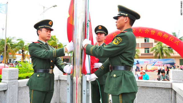 Soldiers raise the national flag during the Sansha city establishment ceremony on July 24, 2012 in Sansha, China.
