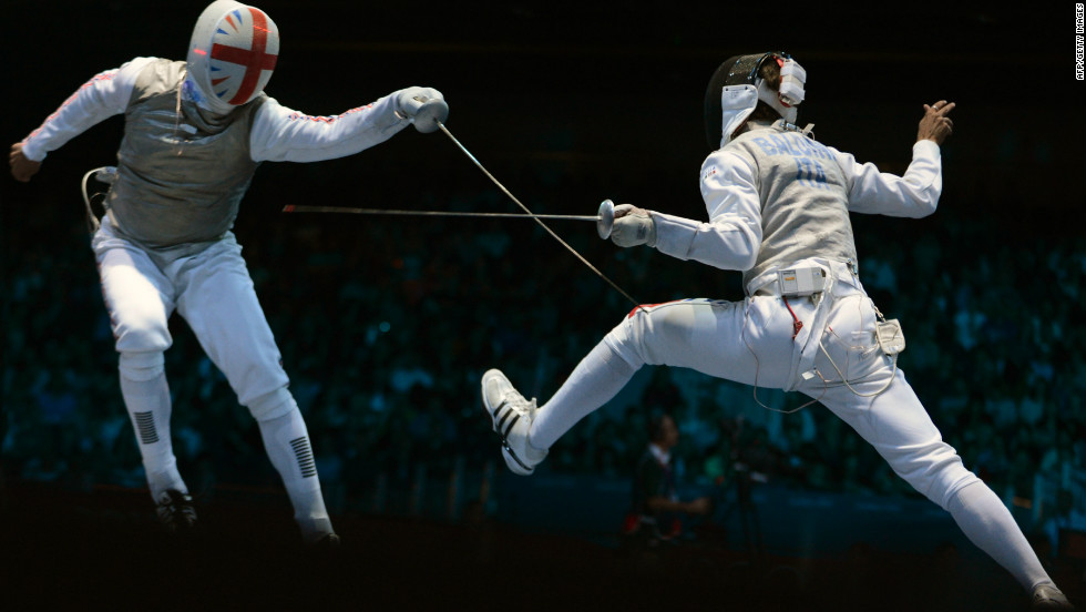 Britain's James Davis, left, fences against Italy's Andrea Baldini during the men's foil team quarterfinals.