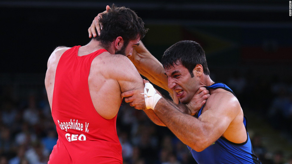 Vladimer Gegeshidze, left, of Georgia wrestles with Saman Tahmasebi of Azerbaijan during their men's Greco-Roman 84-kilogram wrestling 1/8 final bout Monday.