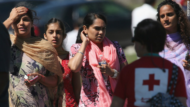 People look on in front of a Sikh temple in Oak Creek, Wisconsin, where a gunman fired upon people at a service on Sunday.