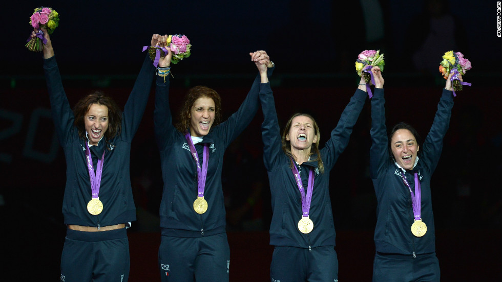 (From L) Italy's Elisa Di Francisca, Arianna Errigo, Valentina Vezzali and Iliara Salvatori celebrate with their gold medals on the podium of the women's foil final on August 2.