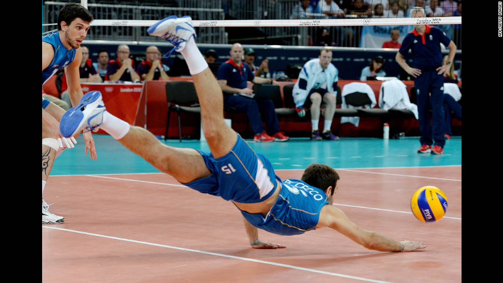 Argentina's Luciano de Cecco dives for a ball during the men's preliminary volleyball match with Great Britain.
