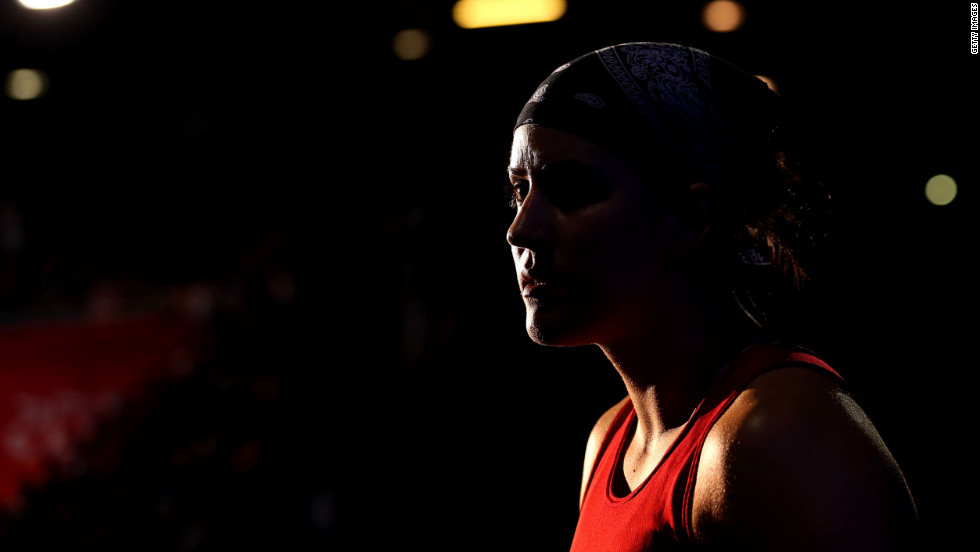 Mary Spencer of Canada watches Jinzi Li of China during the women's middle 75-kilogram boxing quarterfinals.