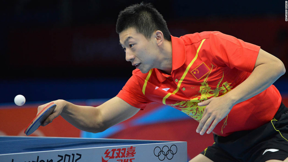 China's Ma Long returns the ball during his men's team table tennis semifinal match against Germany.