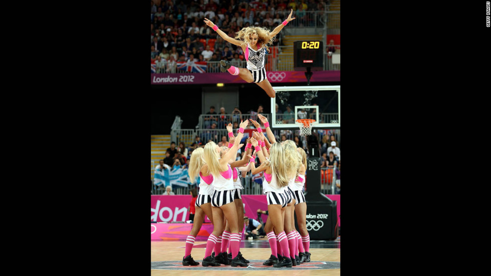 The Red Foxes dance team performs during a timeout in the Great Britain-China men's basketball preliminary game