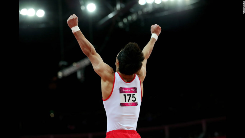 Gymnast Hak Seon Yang of South Korea celebrates his vault.