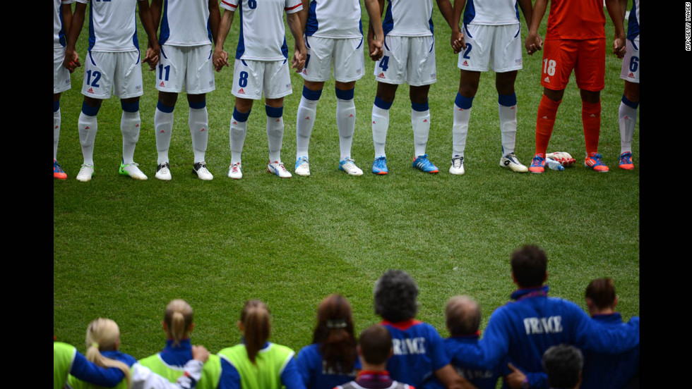 France and Japan stand in front of each other before the women's football semifinal.