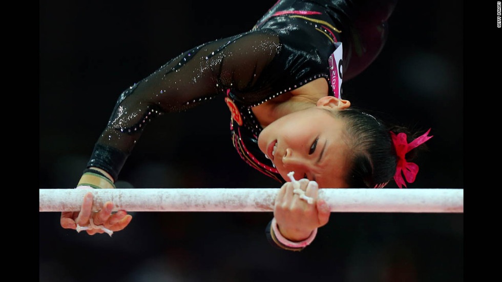Kexin He of China competes in the artistic gymnastics women's uneven bars final.