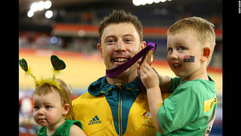 Bronze medallist Shane Perkins of Australia celebrates with his family after the medal ceremony for the men's sprint track cycling final.