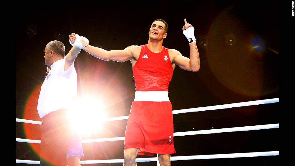 Anthony Ogogo of Great Britain celebrates his victory over Stefan Hartel of Germany during the men's middle 75-kilogram boxing.