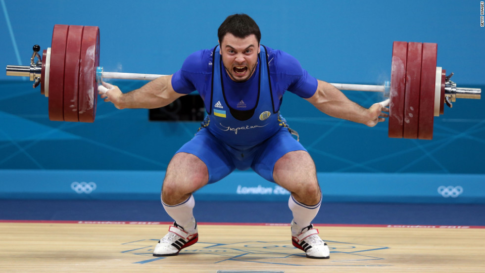 Oleksiy Torokhtiy of Ukraine competes in the men's 105-kilogram weightlifting.