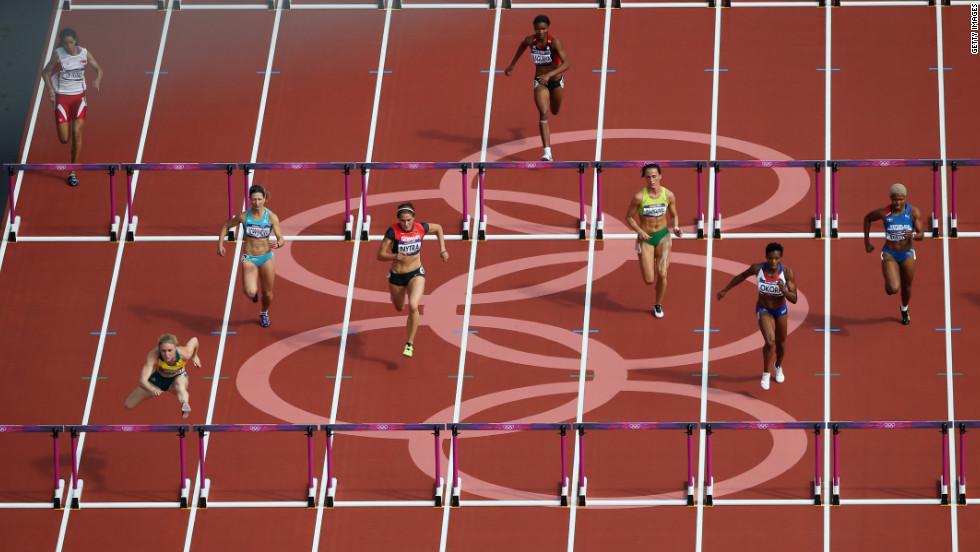 Athletes compete in the women's 100-meter hurdles at Olympic Stadium.