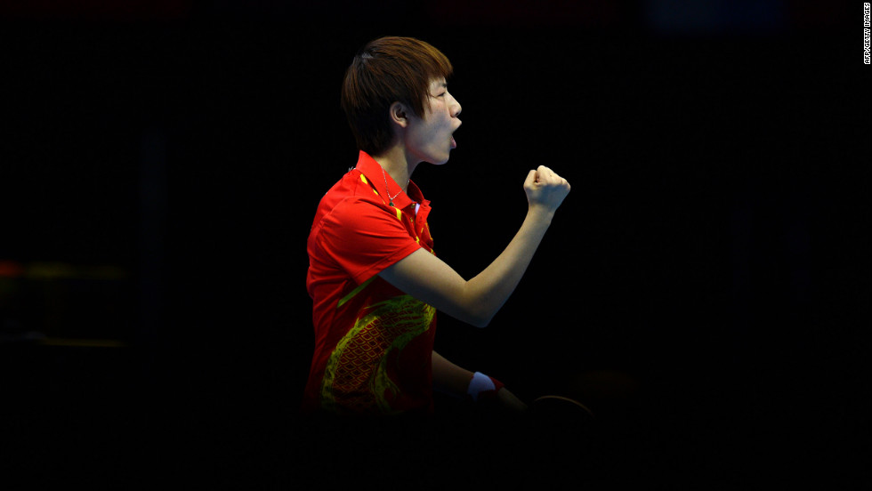 China's Ding Ning celebrates after winning a point against South Korea's Kim Kyung-Ah in the women's table tennis semifinal.