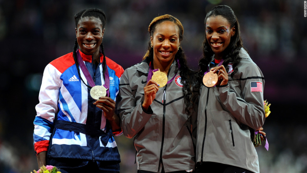 From left, silver medalist Christine Ohuruogu of Great Britain, gold medalist Richards-Ross and bronze medalist DeeDee Trotter of the United States show off their medals during Sunday's ceremony at Olympic Stadium in London.