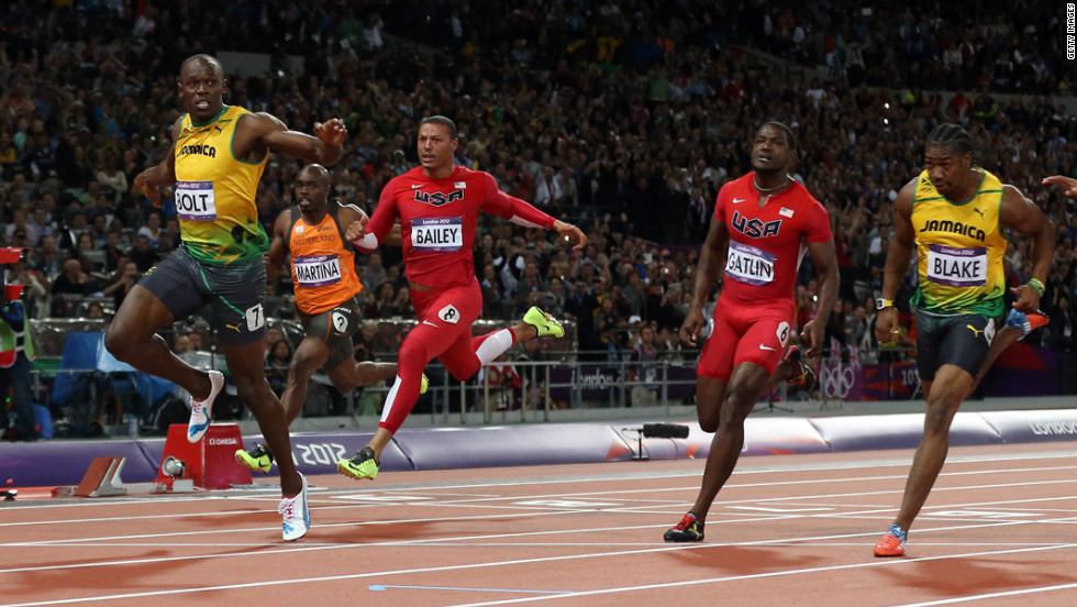 Usain Bolt of Jamaica crosses the finish line to win gold in the men's 100m final.
