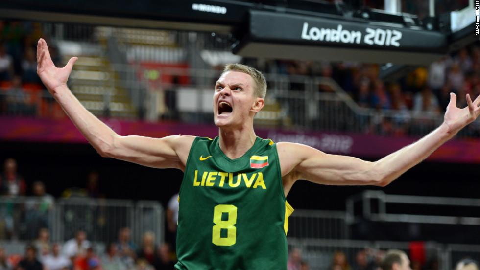 Lithuanian guard Renaldas Seibutis celebrates after scoring during the men's basketball preliminary round game against Tunisia.