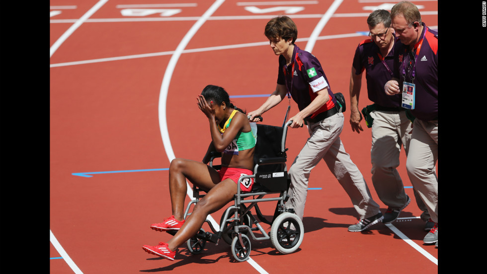 Genzebe Dibaba of Ethiopia is taken off the track in a wheelchair after competing in the women's 1,500-meter heat.
