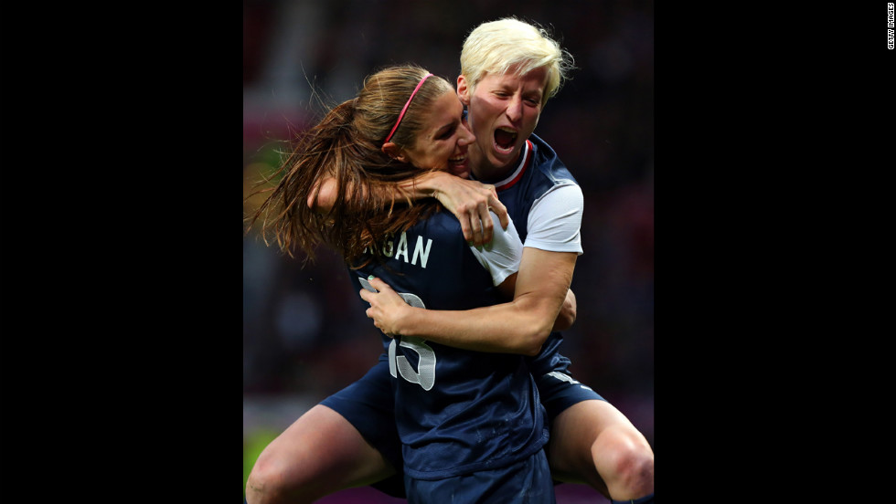 Alex Morgan, left, celebrates with Megan Rapinoe after scoring the winning goal against Canada in the women's soccer semifinal.