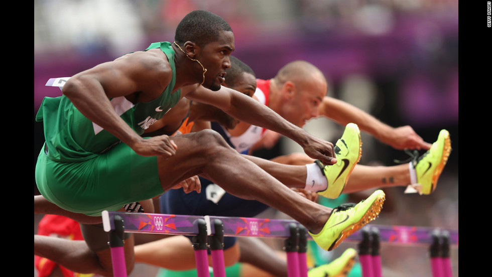 Left to right: Selim Nurudeen of Nigeria, Gregory Sedoc of Netherlands and Andrew Turner of Great Britain compete in the men's 110-meter hurdles round 1 heat on Tuesday, August 7.