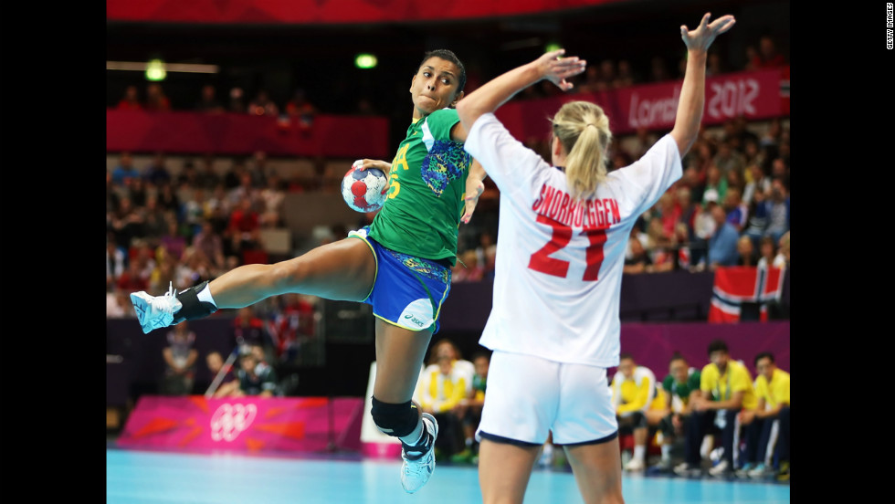 Fernanda Silva, left, of Brazil shoots over Goril Snorroeggen of Norway during the women's quarterfinal hand ball match.