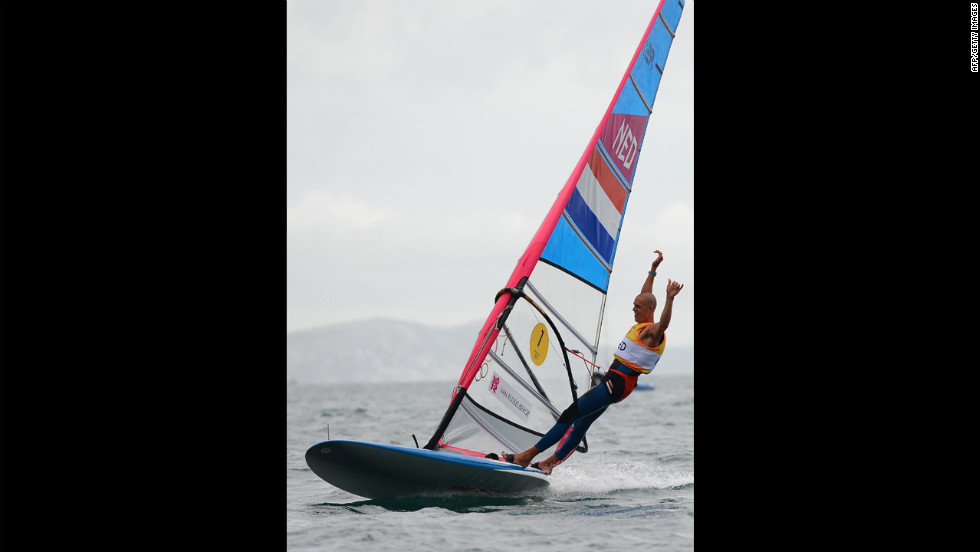 Dorian van Rijsselberge of the Netherlands celebrates after winning the gold medal in the men's RS-X class race in Weymouth, England.