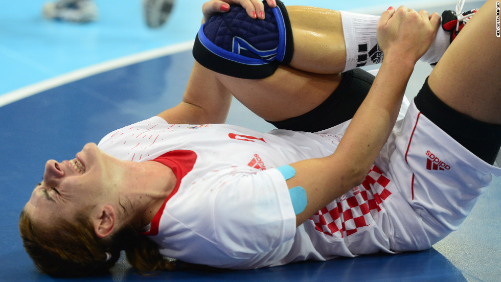 Croatia's centerback Miranda Tatari reacts after falling during the women's quarterfinal handball match against Spain.