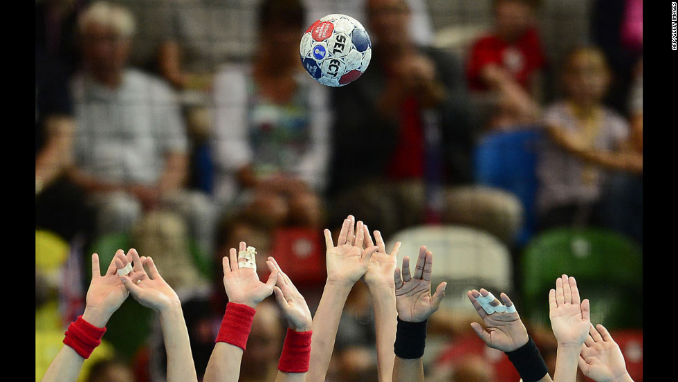 The Spanish handball team's defenders attempt to block the ball during the women's quarterfinal handball match against Croatia.