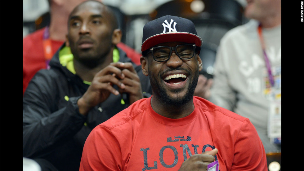 U.S. forward LeBron James, front, and guard Kobe Bryant attend the U.S. women's quarterfinal basketball game against Canada.