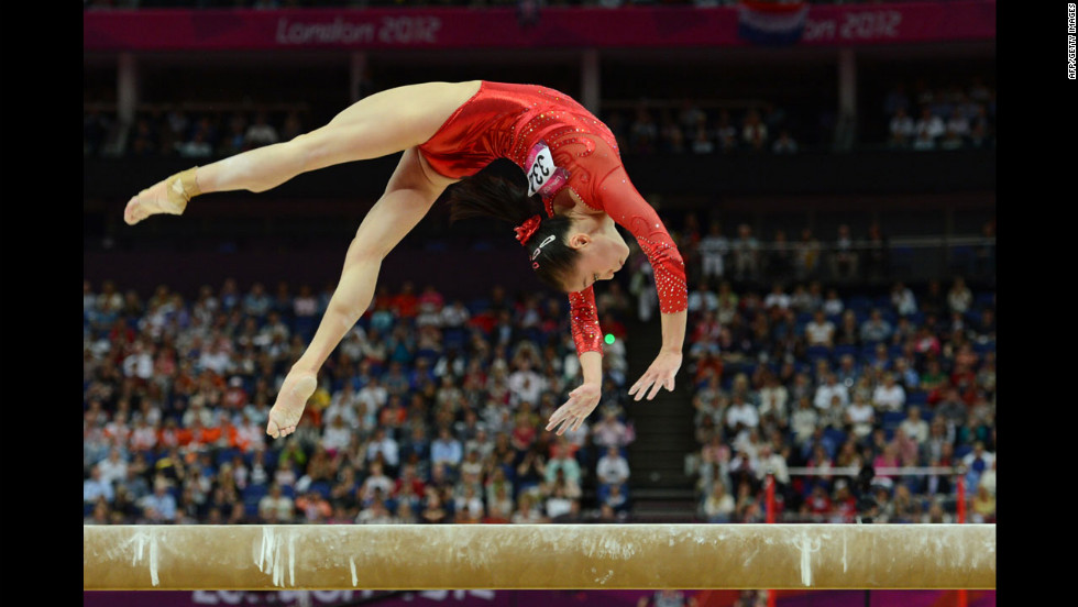 Chinese gymnast Sui Lu performs on the balance beam during the women's gymnastics event.