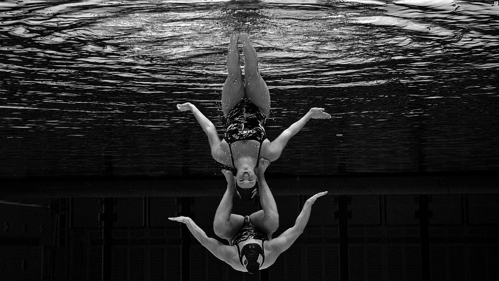 The U.S. pair of Mary Killman and Mariya Koroleva combine in the qualification tournament for the women's duets synchronized swimming.