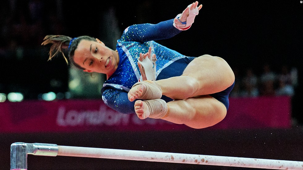 Great Britain's Beth Tweddle swings her way to bronze in the women's uneven bars final.