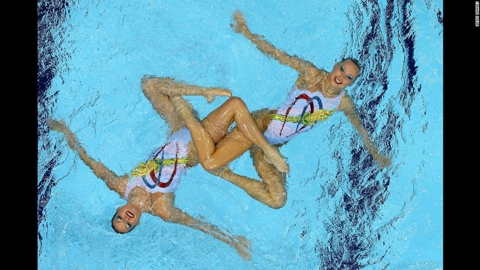 Mary Killman and Mariya Koroleva of the United States compete in the women's duets synchronized swimming free routine final.